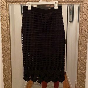 Cute black pencil skirt with lace detail.